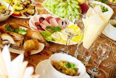 Delicious food. Dining table with a great abundance of different food Royalty Free Stock Photography