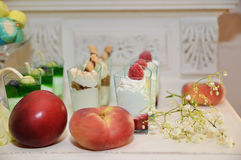 Delicious food, cakes and fruits on the table Stock Photos