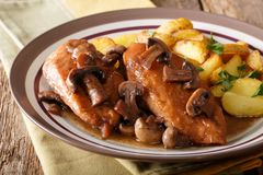 Delicious food: chicken breast in Marsala sauce with mushrooms a Stock Image