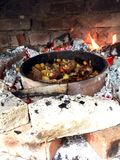 Delicious Food on fire. Serbian cousine. Delicious food on fire. Cooking outside. Serbian cousine Royalty Free Stock Photos