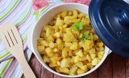Delicious food , fried potatoes in a beautiful dish. With vegetables Royalty Free Stock Photos