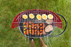 Delicious food grilling on a grill Royalty Free Stock Photography