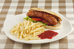 A delicious hot dog sandwich with french fries Stock Photo