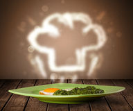 Delicious food plate with chef cook hat Royalty Free Stock Photo