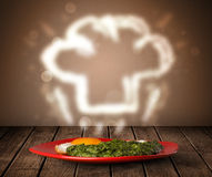 Delicious food plate with chef cook hat Stock Photos