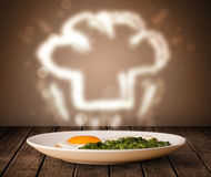 Delicious food plate with chef cook hat Stock Photo