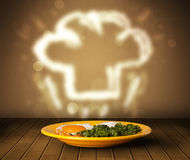 Delicious food plate with chef cook hat Royalty Free Stock Photos
