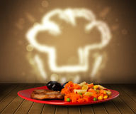 Delicious food plate with chef cook hat Royalty Free Stock Image