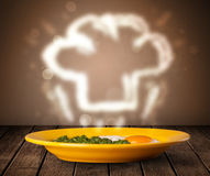 Delicious food plate with chef cook hat Royalty Free Stock Images