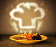 Delicious food plate with chef cook hat Stock Image