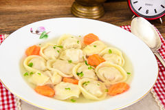Delicious Food: Soup Dumplings Pelmeni and Carrot Royalty Free Stock Photos