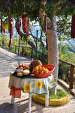 Delicious food, specialties of Calabria. Specialties of the region Calabria, bergamot, pecorino cheese, pumpkin, tomatoes, red wine , oranges and saussages royalty free stock photos