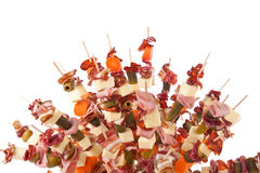 Delicious food on sticks Stock Images