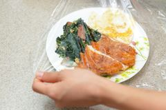 Foods covered with cling film. Delicious foods covered with cling film Royalty Free Stock Photography
