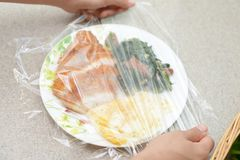 Foods covered with cling film. Delicious foods covered with cling film Royalty Free Stock Photos