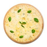 Delicious four cheese pizza with basil leaves Royalty Free Stock Photo