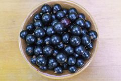 Delicious, fragrant black currant berries in a bowl on the table royalty free stock images
