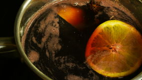 Delicious fragrant mulled wine stock footage