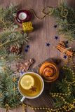 Tea with fragrant pastries on a wooden background with Christmas-tree decorations royalty free stock photography