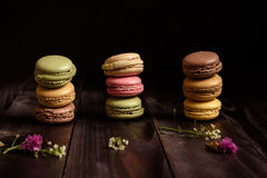 Delicious french dessert. Colorful macaroons on the wooden table Royalty Free Stock Images