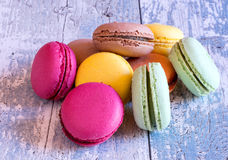 Delicious french macaroons on wooden table Stock Image