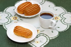 Delicious french pastries. Profiteroles stuffed with vanilla ice cream Shallow DOF stock image