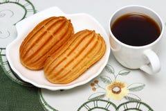 Delicious french pastries. Profiteroles stuffed with vanilla ice cream Shallow DOF royalty free stock photos