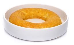 Delicious French ring cake, named savarin. On white stock image
