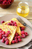 Delicious French toast with raspberries Stock Photos