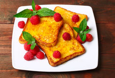 Delicious French toast with raspberries and honey Stock Photo