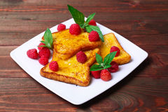 Delicious French toast with raspberries and honey Royalty Free Stock Photography