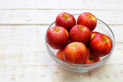 Delicious fresh apples in glass on white wood Royalty Free Stock Photos