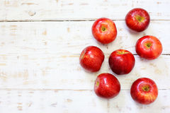 Delicious fresh apples in glass on white wood Royalty Free Stock Photo