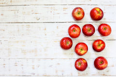 Delicious fresh apples in glass on white wood Stock Photography