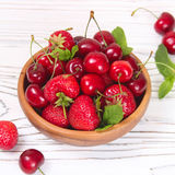 Delicious fresh berries of cherries and strawberries. On a wooden background Stock Images