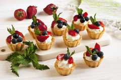 Delicious fresh berries mini-cakes Stock Photos