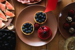Delicious fresh blueberry and strawberry cakes on the holiday table royalty free stock photos