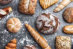 Delicious fresh bread on rustic background Royalty Free Stock Photo