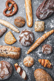 Delicious fresh bread on rustic background Royalty Free Stock Photos