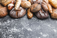 Delicious fresh bread on rustic background Stock Photo