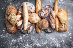 Delicious fresh bread on rustic background Stock Images