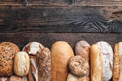 Delicious fresh bread on wooden background Royalty Free Stock Photo