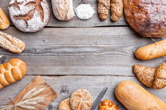 Delicious fresh bread on wooden background Stock Images