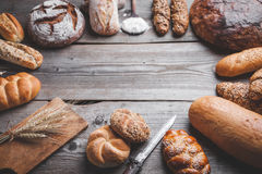 Delicious fresh bread on wooden background Royalty Free Stock Image