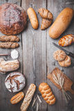 Delicious fresh bread on wooden background Royalty Free Stock Photos