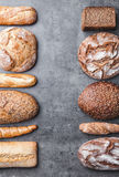 Delicious fresh bread on wooden background Stock Photos
