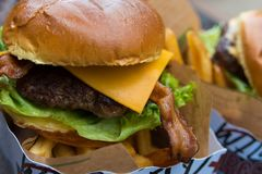 Delicious fresh burger close up. Selective focus with shallow depth of field royalty free stock photo