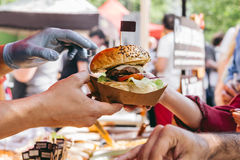 Delicious fresh burger on food market, ready to eat. Close-up.  Stock Photo
