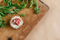 Delicious fresh canape with gorgonzola parmezan and strawberry a. Nd arugula on wooden desk, top view Royalty Free Stock Image