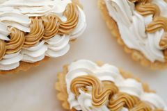 Delicious fresh cream cakes and condensed milk Royalty Free Stock Image